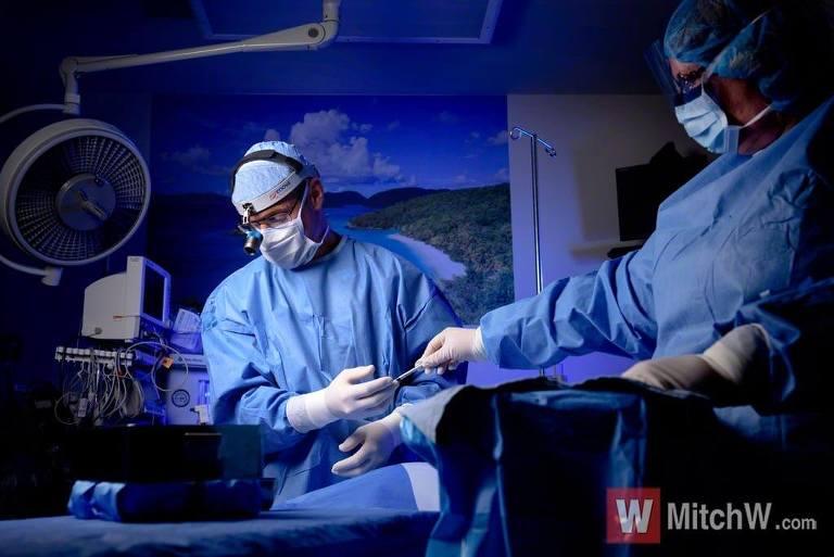 plastic surgeon at work photo albany ny